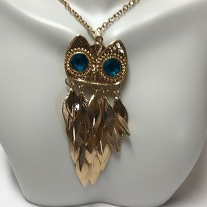 Jewelry - Gold tone owl with blue eyes necklace